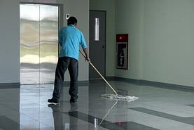 Man Dust Mopping