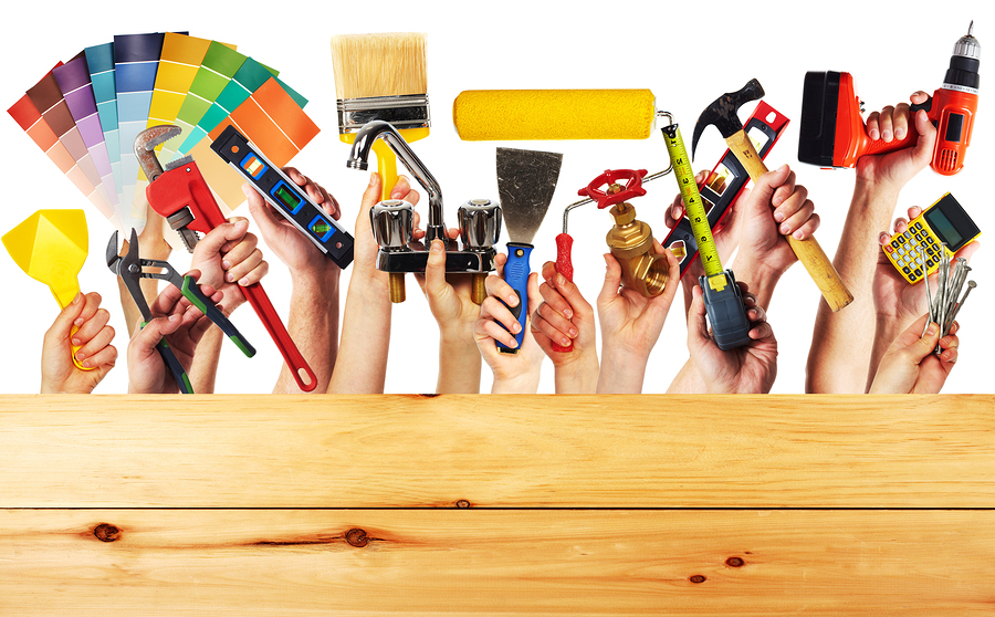 bigstock-Hands-with-construction-tools--66023965