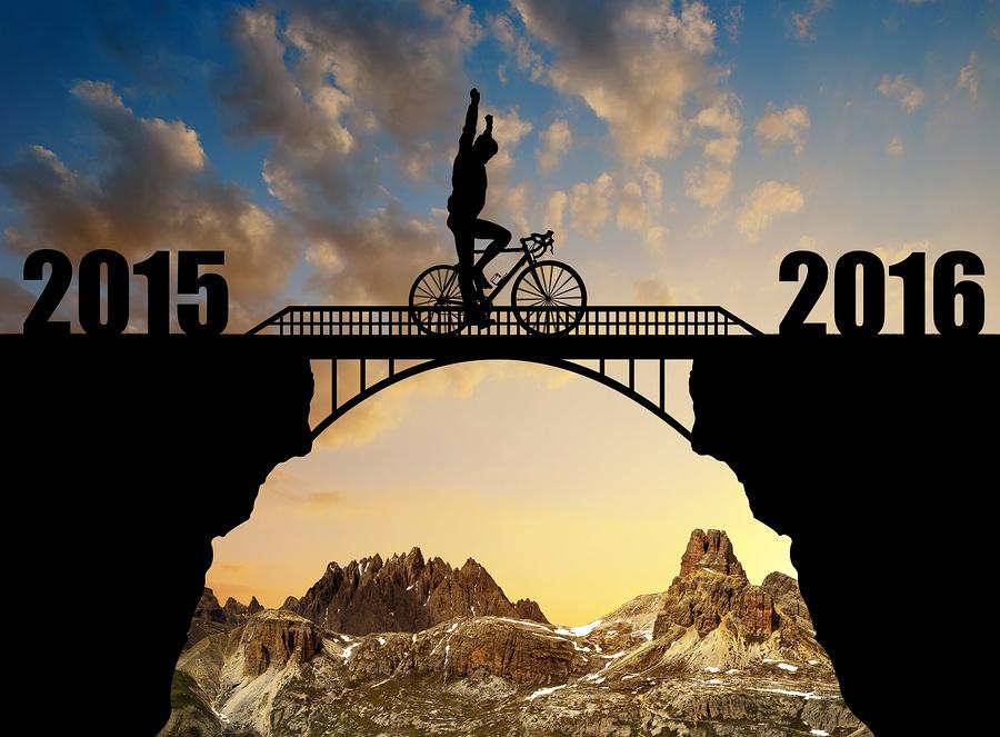 bigstock-Cyclist-riding-across-the-brid-99322457.jpg