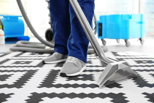 bigstock-Dry-cleaner-s-employee-removin-176766937.jpg