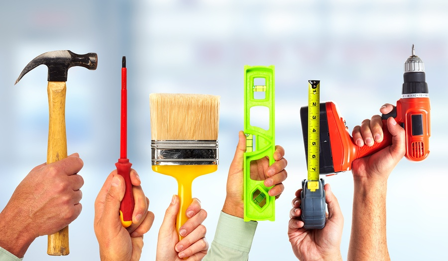 bigstock-Hands-of-handyman-with-tools--107634860.jpg